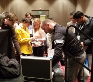 Lunch and Learn Attendees inspecting Carbon Parts